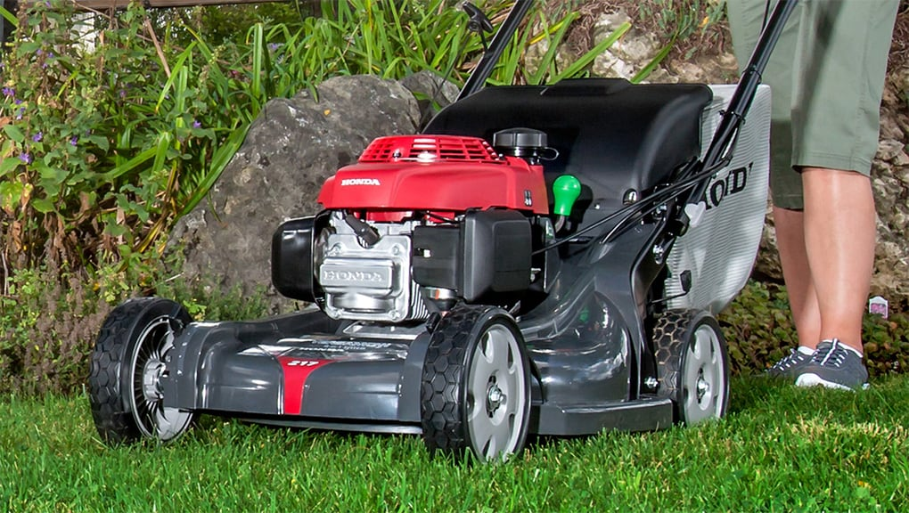 Delightful Close Up View Of A Lawn Mower On Grass