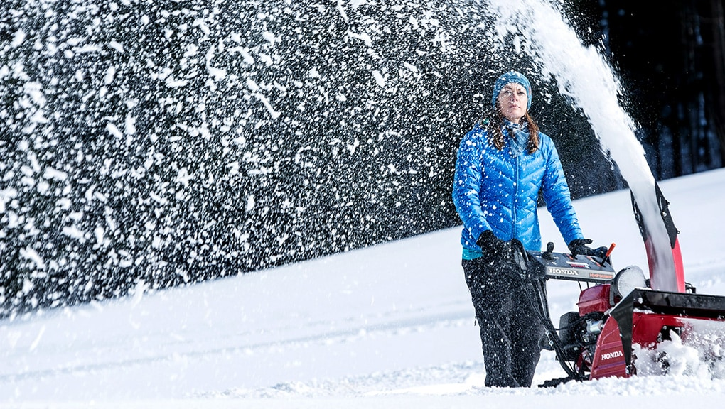 Image of woman using snow blower